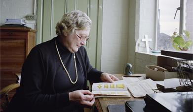 Joyce Green, final owner of Newman Brothers sat at her desk in the office.